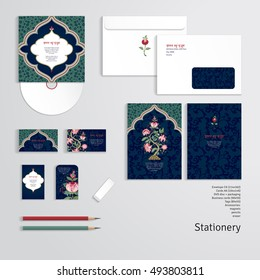 Vector templates. Envelope, cards, business cards, tags, disc with packaging, pencils, eraser. Dark backdrop. Tree of Life and indian decorative frame. Motives of the paintings of ancient fabrics.