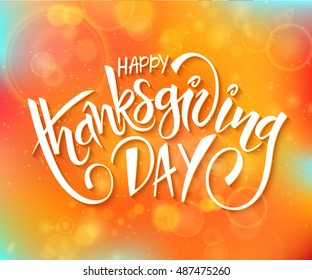 vector thanksgiving day greeting lettering phrase - happy thanksgiving day - on blur autumn background with flares.