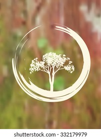 Vector Tree and Zen Circle Illustration on a Natural Blurred Background