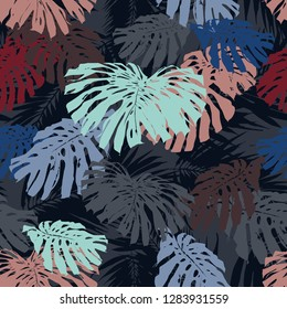 Vector tropical elaves seamless pattern blue color trendy background. Textures exotic floral on a dark. Beautiful leafs monstera camouflages jungle print.