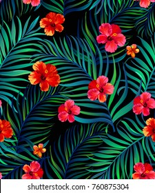 Vector tropical seamless pattern with hibiscus flowers and palm leaves.