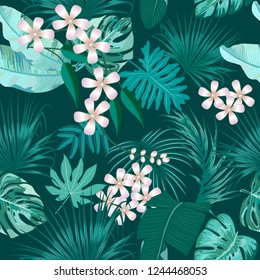 Vector tropical seamless pattern in Quetzal Green colors. Botany design, jungle leaves of palm tree and flowers.