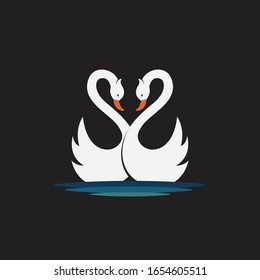 Vector of two white swan design on black background. Wild Animals. Birds. Easy editable layered vector illustration.