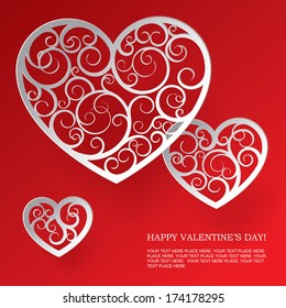 Vector valentine greeting card with tree paper patterned hearts against a red background