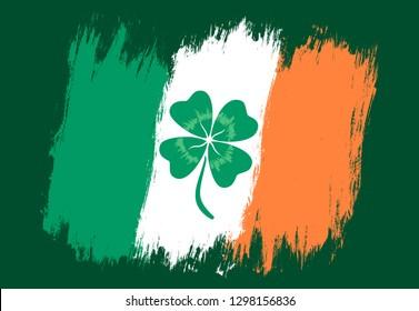 Vector vintage Ireland flag with lucky clover. Vintage flag of Ireland with lucky four leaf clover.