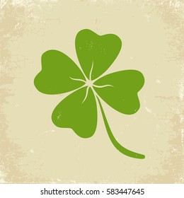 Vector vintage poster with clover for Patrick's day. Green clover on old paper
