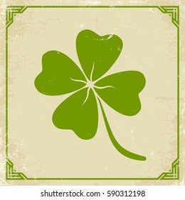 Vector vintage poster with clover for Patrick's day. Green clover on old paper.