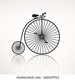 vector vintage retro bicycle icon with reflection, black silhouette isolated