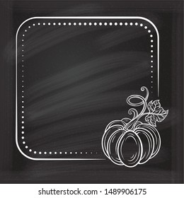 Vector vintage square frame on a chalkboard background with autumn pumpkin decoration.