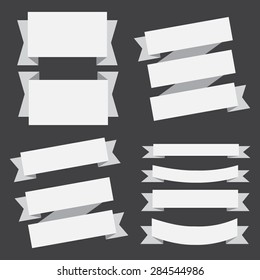 vector white banners ribbons set on a black background.