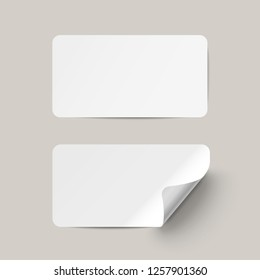 Vector white realistic paper adhesive stickers with curved corner on transparent background.