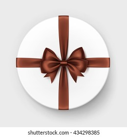 Vector White Round Gift Box with Shiny Brown Chocolate Satin Bow and Ribbon Top View Close up Isolated on Background