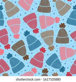 Vector winter hat pattern in blue and red. Simple doodle beanie and snow. Great for background, wallpaper, wrapping paper, packaging, fashion.