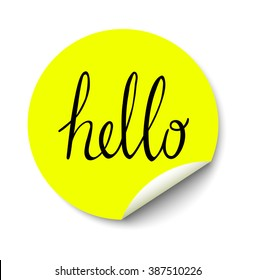 Vector yellow circle sticker with curled corner and hello text inside