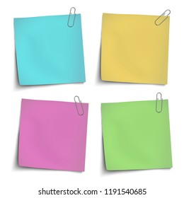 Vector yellow, green, rosy, blue sticky notes attached by metallic paper clips isolated on white background
