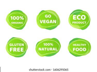 Vegan bio food logo set. Green organic product sticker design with doodle elements, eco nature friendly emblem frames. Vegan food symbols for stickers, labels and logos
