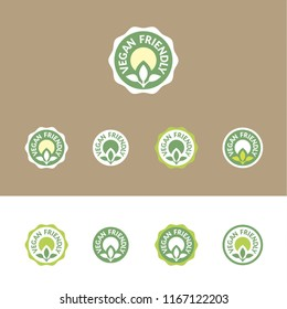 Vegan Friendly – set of vector icons (stickers, labels, pictograms), in various options of shape and colors within a green palette. On white and brown (kraft paper's color) background.