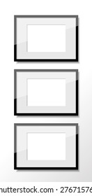 Vertical group of three photo frames.