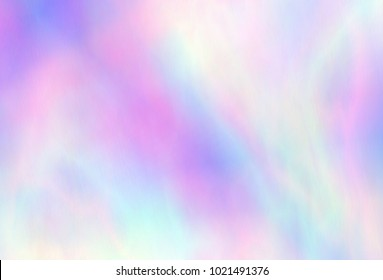 Very beautiful iridescent paper. Holographic Foil. Wonderful magic background. Colorful wallpaper. Rainbow abstract sky. Trendy art