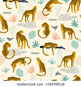 Vestor seamless pattern with leopards and abstract tropical leaves. Trendy style.