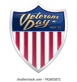 Veterans Day. Glossy varnished badge. Realistic silver shield with an enamel. Dark blue field, red and white stripes based on a Flag of the United States. Golden calligraphic logo in the retro style.
