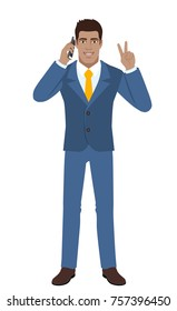 Victory! Two fingers up. Businessman talking on the mobile phone and showing victory sign. Full length portrait of Black Business Man in a flat style. Vector illustration.