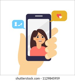 video call with friend. talking about love and fashion. video call with smarthphone. video call with friends. Incoming call on smartphone screen. Calling service. Hand holds smartphone,