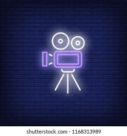 Video camera neon sign. Luminous signboard with retro film production equipment. Night bright advertisement. Vector illustration in neon style for vintage movie, filmmaking, videographer, creativity