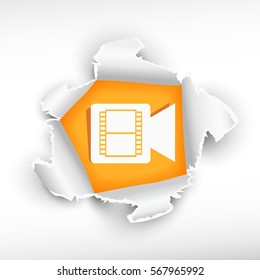 Video camera sign icon and breakthrough paper hole with ragged edges with a space for your message.