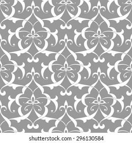Vintage abstract floral seamless pattern with intersecting curved elegant stylized leaves and scrolls forming abstract floral ornament in Arabic style. Arabesque.
