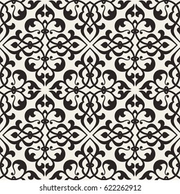 Vintage abstract floral seamless pattern. Intersecting stylized leaves, branches and scrolls forming abstract floral background in Arabic style. Arabesque design.