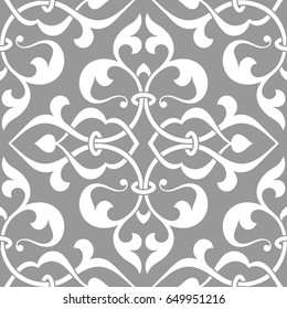 Vintage abstract floral seamless pattern. Intersecting curved elegant stylized leaves and scrolls forming abstract floral background in Arabic style. Arabesque design.
