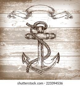 Vintage anchor on wooden background. Hand drawn vector illustration