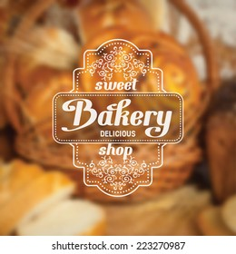 Vintage bakery badge on blurred background