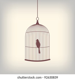 Vintage bird cage with single bird inside.