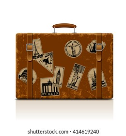 Vintage brown threadbare suitcase with collection of retro grunge vacation & travel labels. Vector illustration. EPS 10