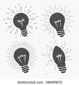 Vintage bulbs set with sunburst. Template for t-shirt, logos, banners, cover and business or art works.