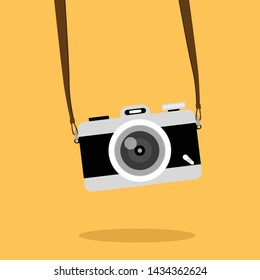 Vintage camera on color background. Retro style toned picture. Minimalistic concept