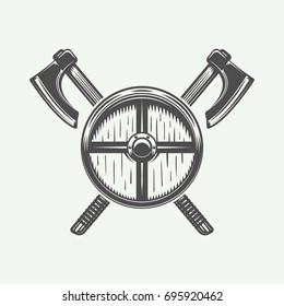 Vintage cross axes and shield in retro style. Can be used for logo, emblem, badge, label, stamp or mark. Monochrome graphic Art. Vector Illustration.