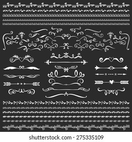Vintage decorative curls and swirls collection. Hand drawn vector design elements on blackboard.