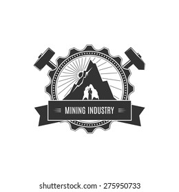 Vintage Emblem of the Mining Industry, Miner Holding a Pickax on a Background of the Sunburst and Mountain, Label and Badge Mine Shaft, Vector Illustration