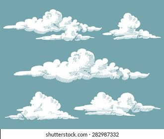 vintage engraved clouds. vector illustration