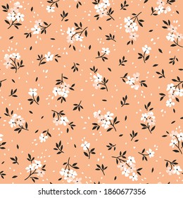 Vintage floral background. Floral pattern with small white flowers on a pale coral background. Seamless pattern for design and fashion prints. Ditsy style. Stock vector illustration.