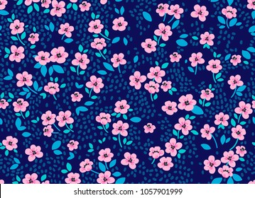 Vintage floral background. Seamless vector pattern for design and fashion prints. Flowers pattern with small pink flowers on a dark blue background. Ditsy style.
