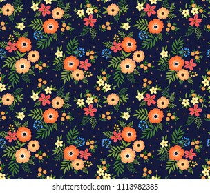 Vintage floral background. Seamless vector pattern for design and fashion prints. Flowers pattern with small orange flowers on a dark blue background. Ditsy style.
