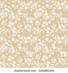Vintage floral background. Seamless vector pattern for design and fashion prints. Flowers pattern with small white flowers on a ivory background. Ditsy style.
