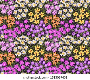 Vintage floral background. Seamless vector pattern for design and fashion prints. Flowers pattern with small colorful flowers on a violet background. Ditsy style.