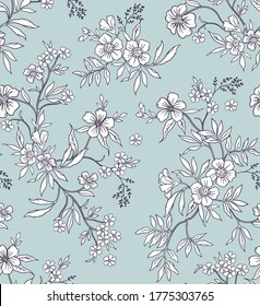Vintage floral background. Seamless vector pattern for design and fashion prints. Flowers pattern with small white flowers on a light blue background. Ditsy style.