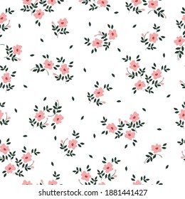 Vintage floral background. Seamless vector pattern for design and fashion prints. Floral pattern with small pink flowers on a white background.