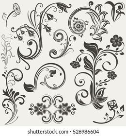 Vintage floral design elements set. Black flowers and branches shapes. Vector illustration.